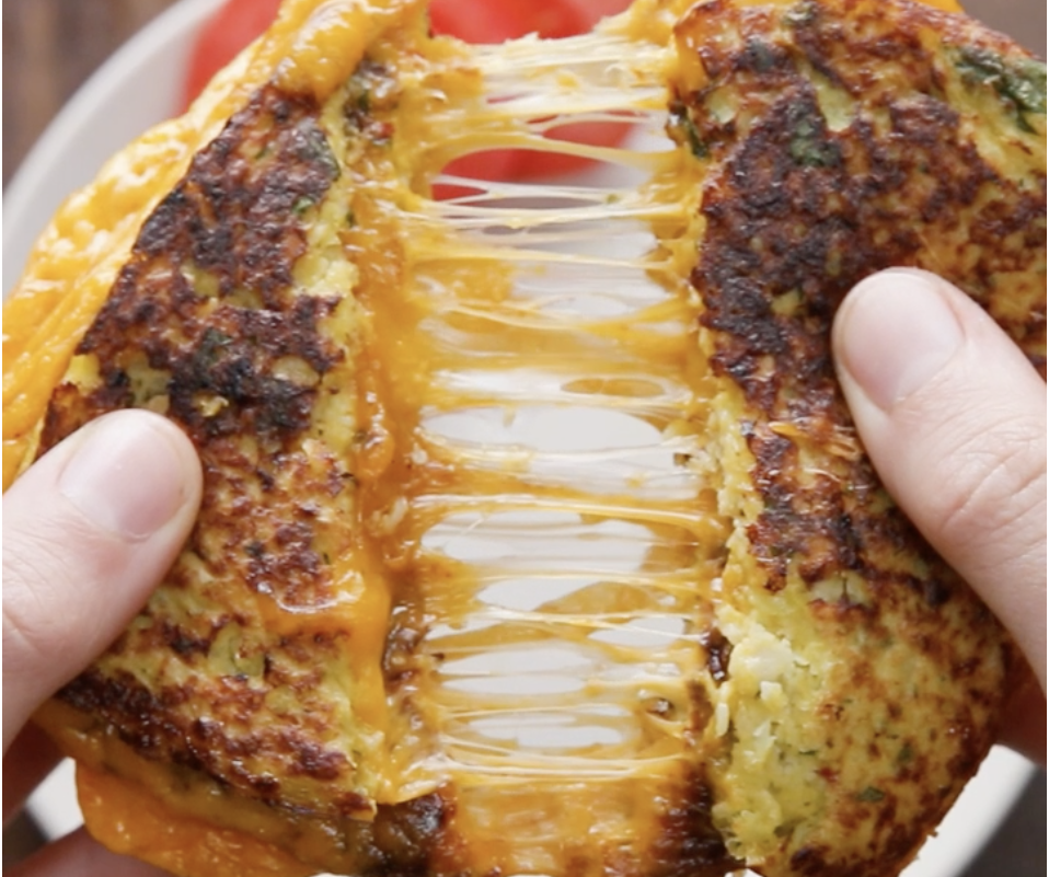 This stringy cauliflower grilled cheese that's getting stretched to its limits:
