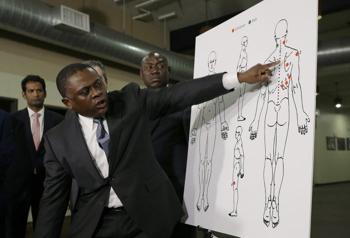 During a news conference on March 30 in Sacramento, California, pathologist Dr. Bennet Omalu points to details on a diagram showing the gunshot wounds he found on the body of Stephon Clark, who was shot by Sacramento police.