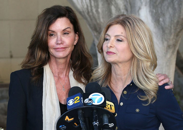Janice Dickinson addresses reporters with celebrity attorney Lisa Bloom in March 2016 in Los Angeles. Dickinson alleges Cosby defamed her by telling the media she made up a story that he drugged and raped her in 1982.