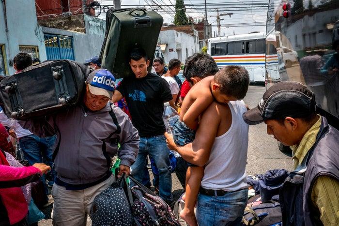 Migrants retrieve their luggage in Puebla.