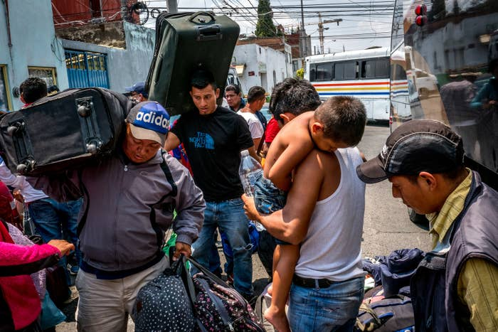 Migrants retrieve their luggage in Puebla.