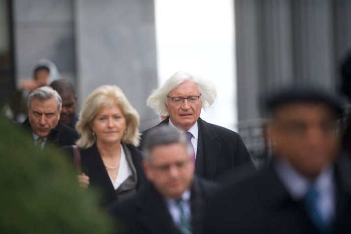 Bill Cosby's attorney Tom Mesereau (center) departs the Montgomery County Courthouse on April 2.