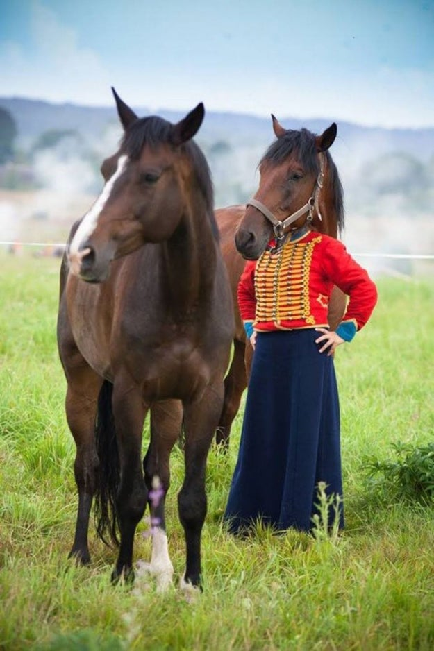 This colorfully-dressed woman with — NBD — a horse's head.