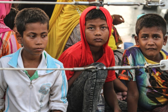 Rohingya refugees detained in Malaysian territorial waters off the island of Langkawi arrive at a jetty in Kuala Kedah, northern Malaysia, on April 3, 2018.