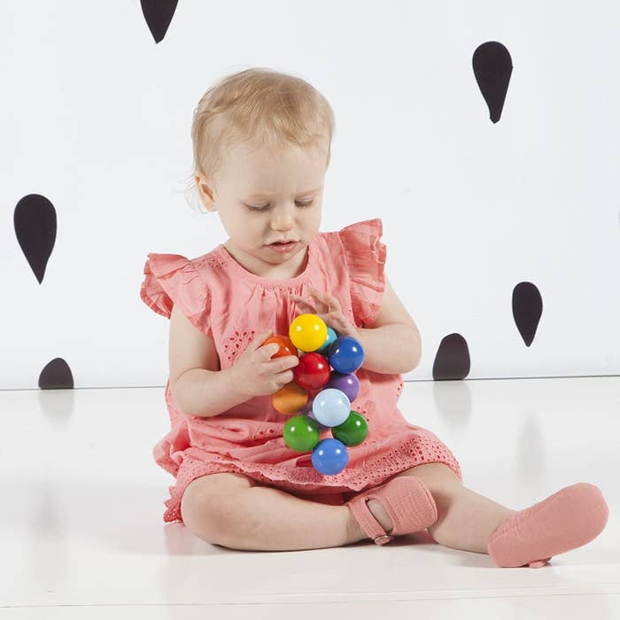 1f1921c73 The classic baby beads wood rattle toy that makes a soothing noise totally  different from the electronic dings of other kids and baby toys.