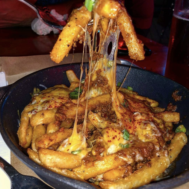 This chili cheese that's dripping onto every last fry on the plate: