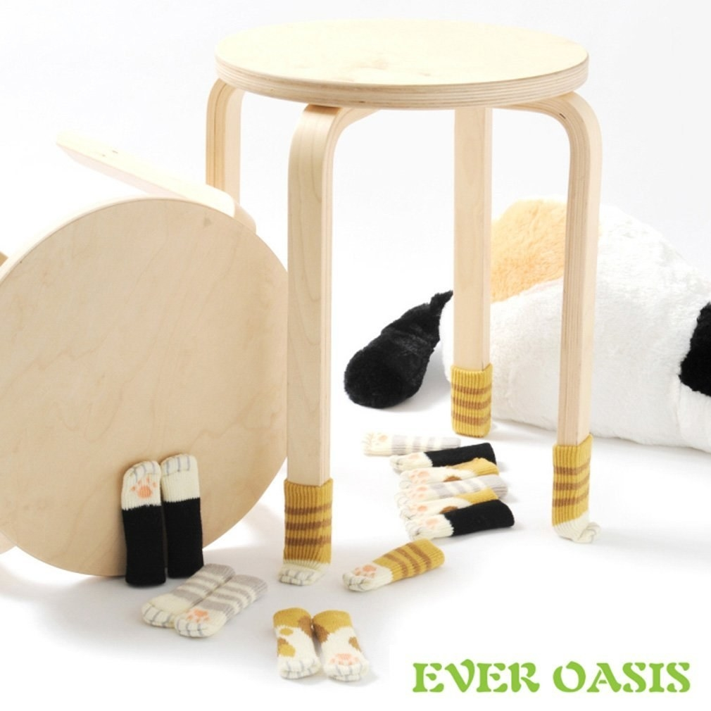 a variety of chair socks on and around a stool