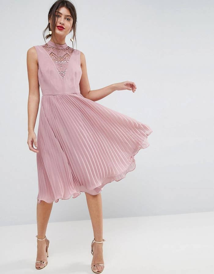 9b92aa82df A pleated midi dress sure to make its way into your closet, even if it has  to beg and pleat for a spot.
