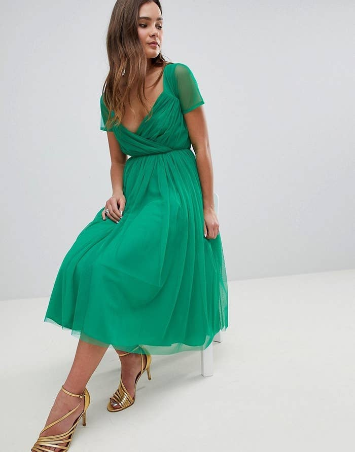 4eefd39b765 A sheer-sleeved tulle dress known to inspire impromptu twirling. Get your  Boomerang app ready