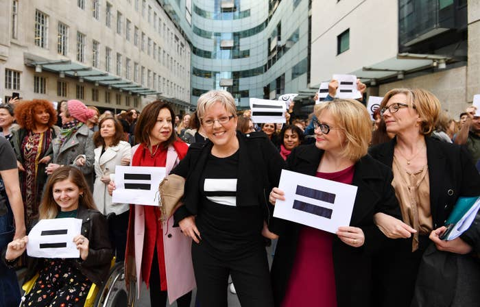 BBC employees gather outside Broadcasting House in London, to highlight equal pay on International Women's Day.