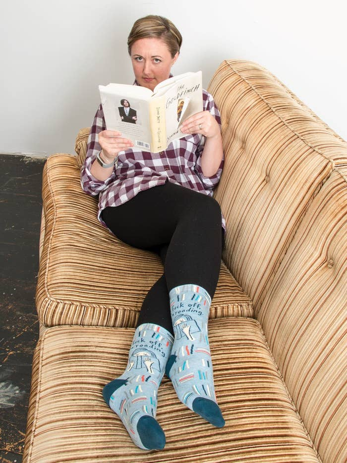 """Just raise your foot to show off these babies, which read """"Fuck off, I'm reading,"""" and they'll get the message. Get them from Amazon for $10.99.Promising review: """"I love Blue Q socks! Since I'm a bookaholic, these are perfect for me. I mean, how dare someone disturb me when I'm deep into another world? LOL Seriously though, I'm now the proud owner of a ton of these and I love them all."""" —Popcorn Reads"""