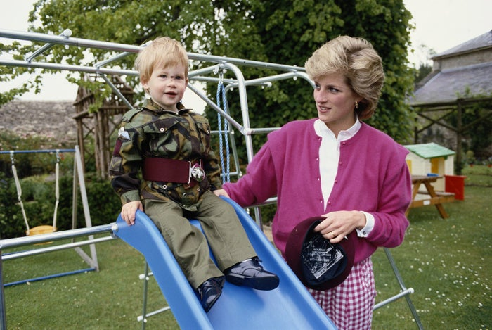 Diana, Princess of Wales, helps her son Harry go down a slide in Gloucestershire, England, on July 18, 1986.