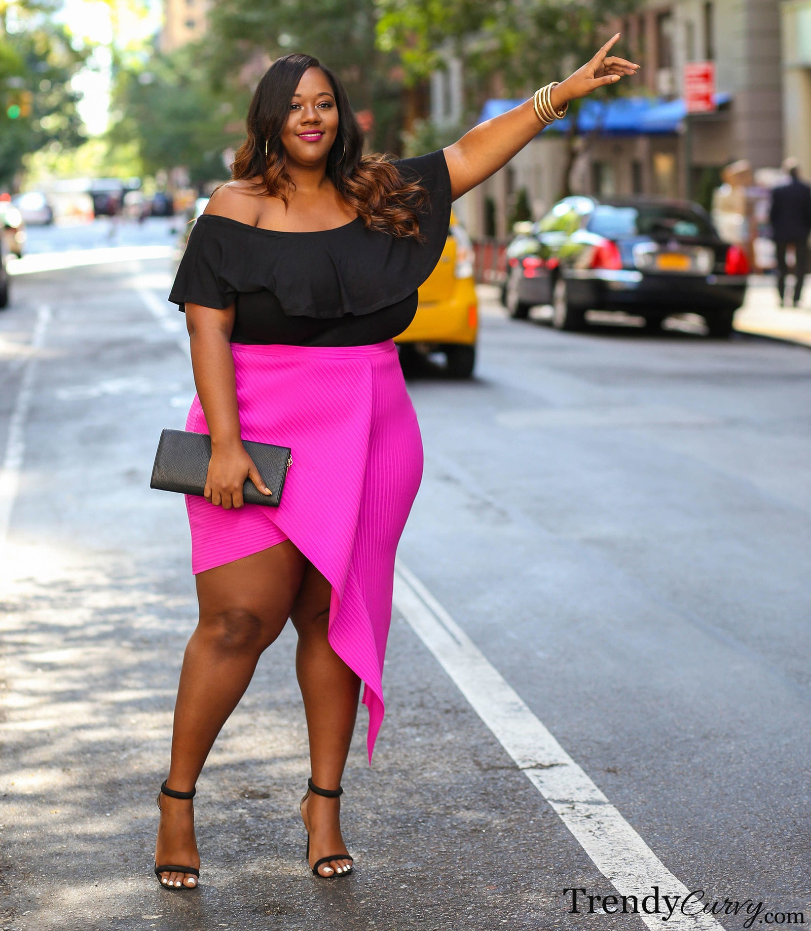 Check out more from Trendy Curvy for how to master angled outfits!Get a similar skirt from Boohoo for $12 (originally $20; available in sizes 14-20 and in three colors).