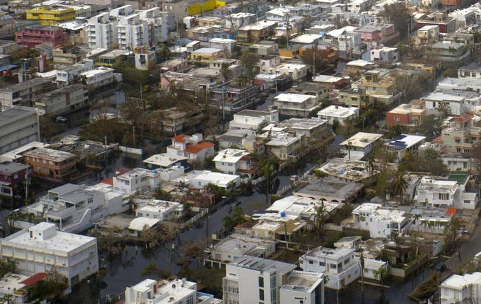 An aerial photo from Sept. 27, 2017, shows buildings surrounded by floodwater a week after Hurricane Maria, in San Juan, Puerto Rico.