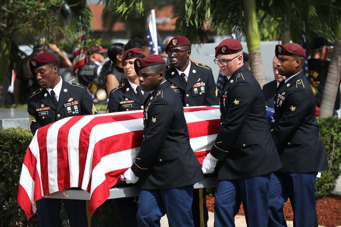US military honor guards carry the casket of US Army Sgt. La David Johnson.