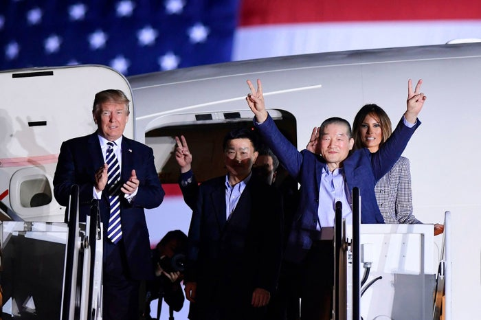 President Donald Trump, along with first lady Melania Trump, greets Kim Sang-duk, Kim Hak-song, and Kim Dong-chul, three Americans detained in North Korea for more than a year, as they arrive at Andrews Air Force Base in Maryland on May 10.