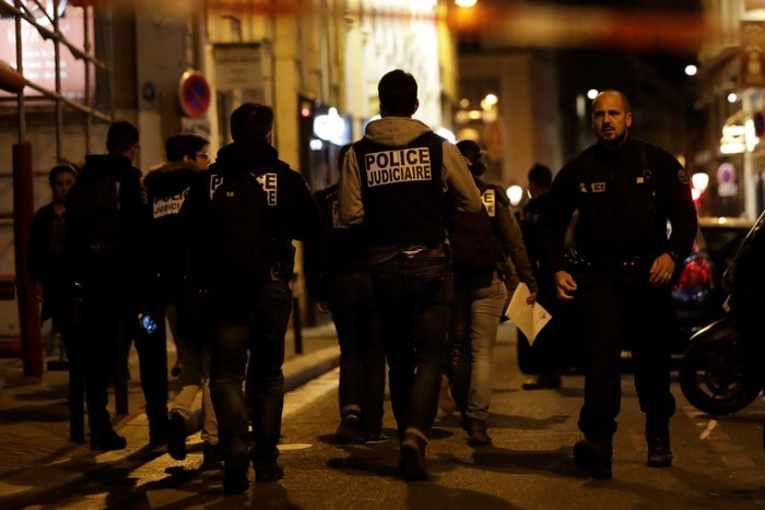 Police walk down a street in central Paris on May 12.