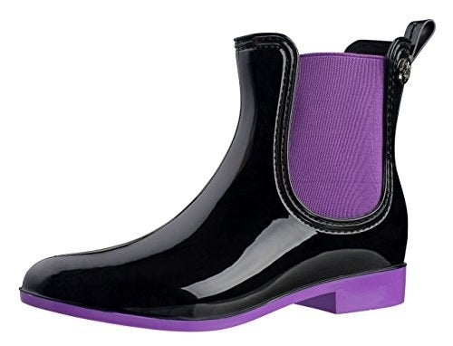 """Promising review: """"Bought these to cope with the mini-flooding that happens whenever it rains in southern California. I normally wear a size 9 shoe, and originally ordered the size 40 (European sizing) boot, but it was too snug — so if you have wide feet or any issues with foot/ankle swelling, as I do, make sure you order a size up. The size 41 fits me well. I'm wearing them for the first time today, and they are doing a good job of keeping my feet dry as I trudge through puddles on my way to and from the office. They're also stylish enough to wear all day in the office, which is a plus! They offer good traction on slick wet pavement."""" —CEBPrice: $25.99+ // Rating: 4.5/5 // Sizes: EU women's whole 36–41 // Colors: nine"""