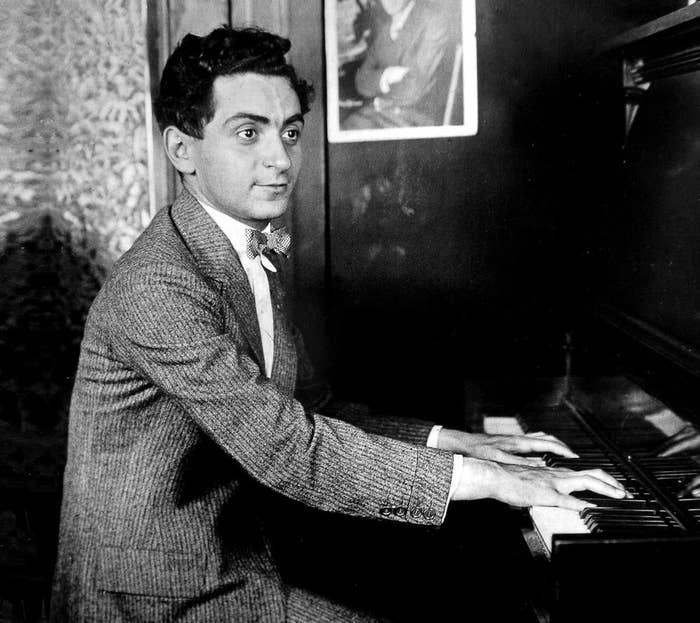 """Irving Berlin is widely considered one of the greatest songwriters in American history. Berlin's music forms a large portion of the most important and influential American popular songs and jazz standards from the early 20th century. Born as Israel Beilin in a Russian hut with a dirt floor, Berlin's family fled Russia to escape the violent massacre of Jews.Irving entered the country through Ellis Island and lived with his family in a Lower East Side windowless basement, where he became fascinated by ragtime and saloon music. While serving in World War I, he wrote """"God Bless America."""" It went on to become one of the most famous patriotic American songs of all time."""