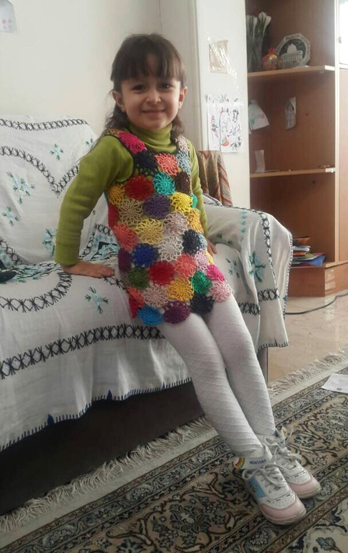 Gabriella wearing a pinafore made by her mother.