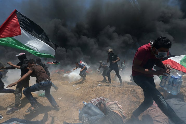 Protesters take part in demonstrations along the Israel–Gaza border on Monday.