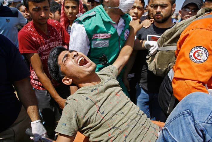 A Palestinian injured in clashes with Israeli forces at the Gaza border on Monday.
