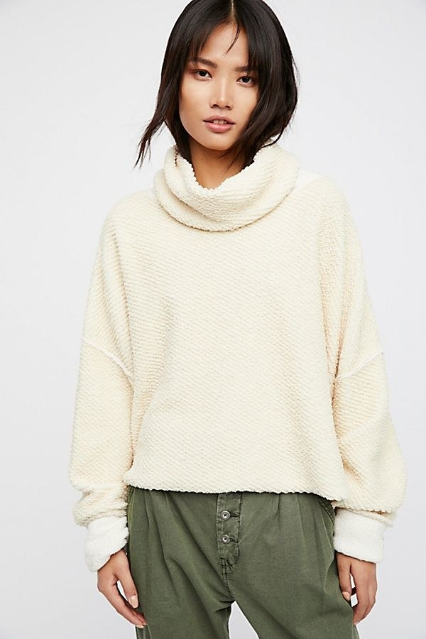 """Promising review: """"This is a godsend. I love it so much. It's comfy, cozy, soft, in good colors, AND flatting!"""" — jspohnGet it from Free People for $78 (available in sizes XS-L and in three colors)."""