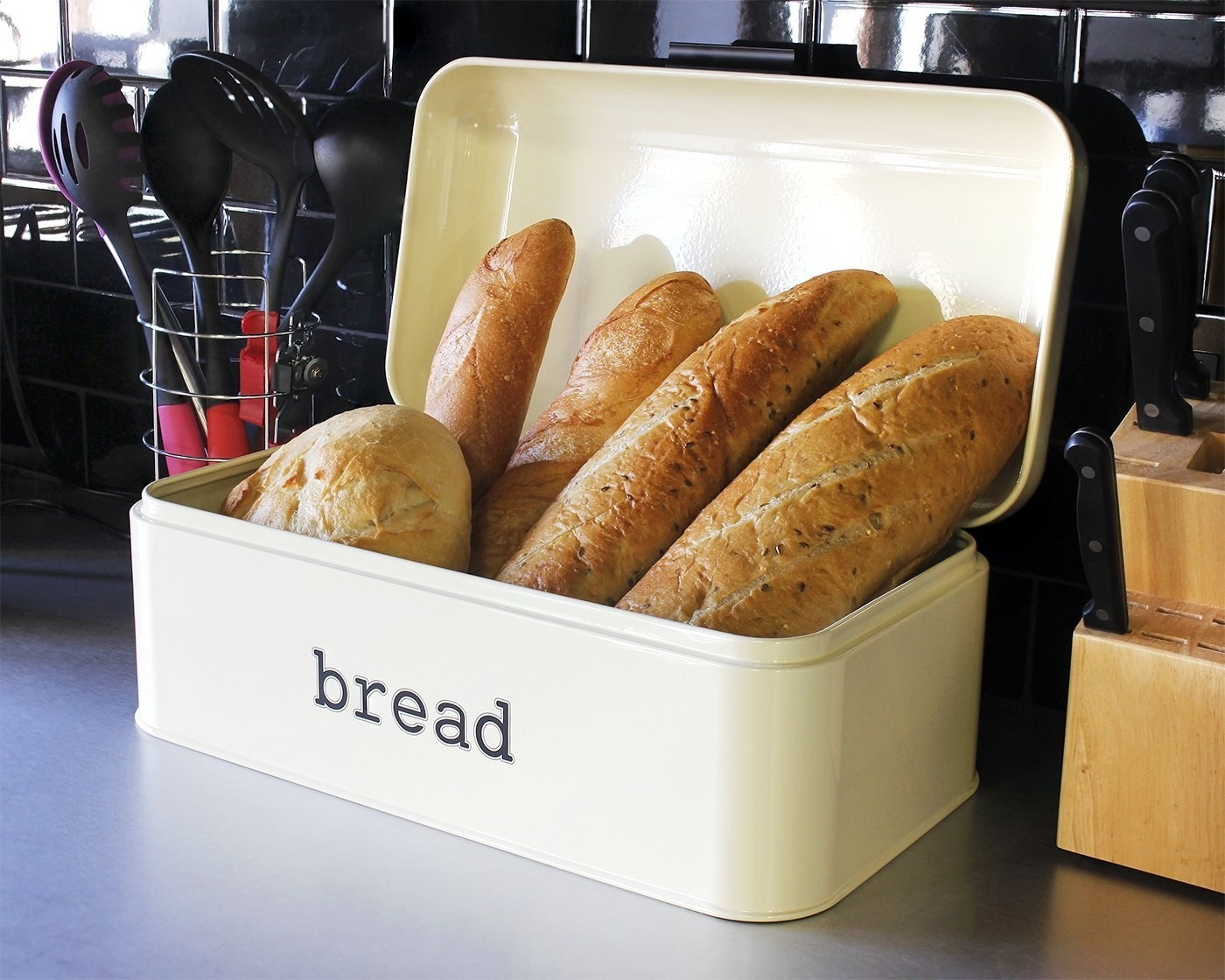 "Promising review: ""I love it! It's a decent size. I fit 1.5 loaves of standard size bread, an open bag of tortilla chips, and an open bag of pretzels. I like to 'hide' the clutter and that stuff was cluttering the corner of my kitchen counter so for me it's perfect."" —ccjade619Get it from Amazon for $27.99+ (available in four colors)."