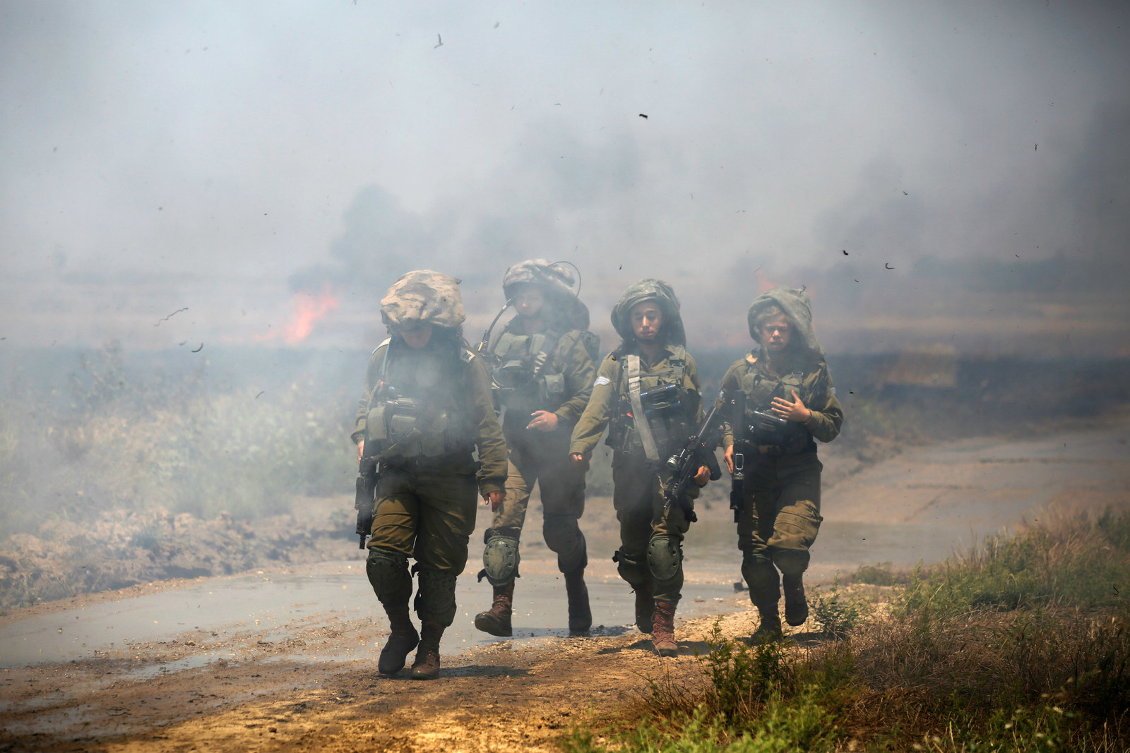 Israeli troops on the Israeli side of the border with Gaza.