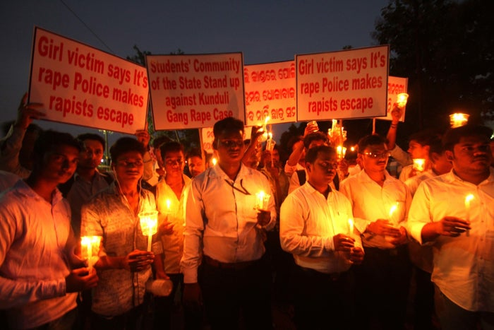 Members of India's youth congress hold a vigil for a girl gang raped in the tribal district Koraput, in the eastern Indian state Odisha's capital city Bhubaneswar, last October.