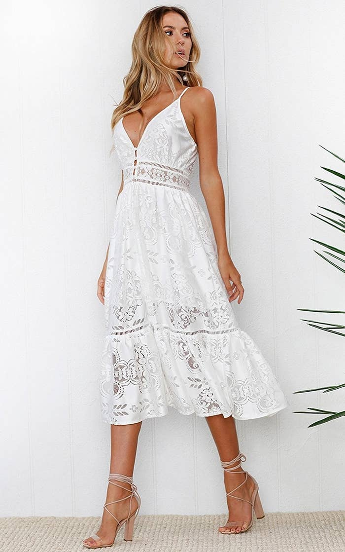 8e0bc6ff350c7 A strappy lace midi dress you could easily pull off as a last-minute  wedding dress. Just imagine it: you, this dress, your lover in the  nighttime, ...