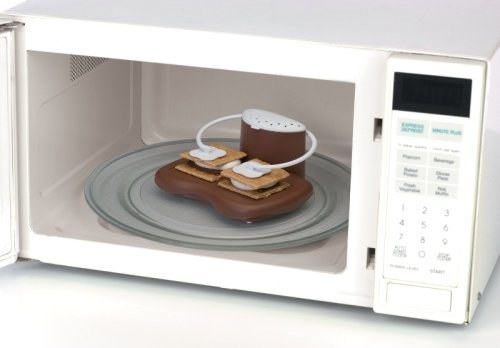 s'mores in microwave with gadget holding them closed