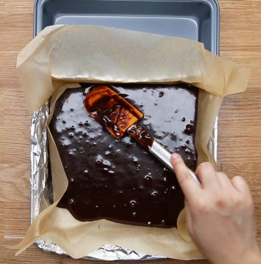 Tightly wrap the tin foil around three sides and then fold the fourth down. Line the foil with parchment paper before pouring the batter.