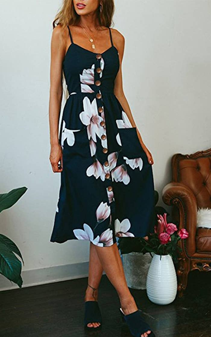 4a63ea975f4 A button-down midi dress that'll become your go-to summer dress for any  occasion.