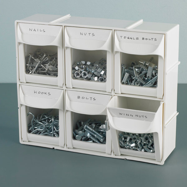 a set of six small filp-out bins in two rows of three with different nuts and bolts in each one