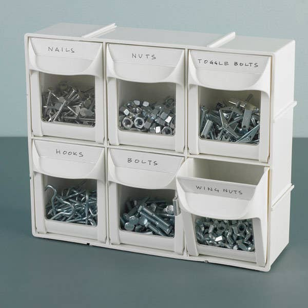 Two rows of three flip-out bins in white filled with nails, bolts, hooks, and other small tools