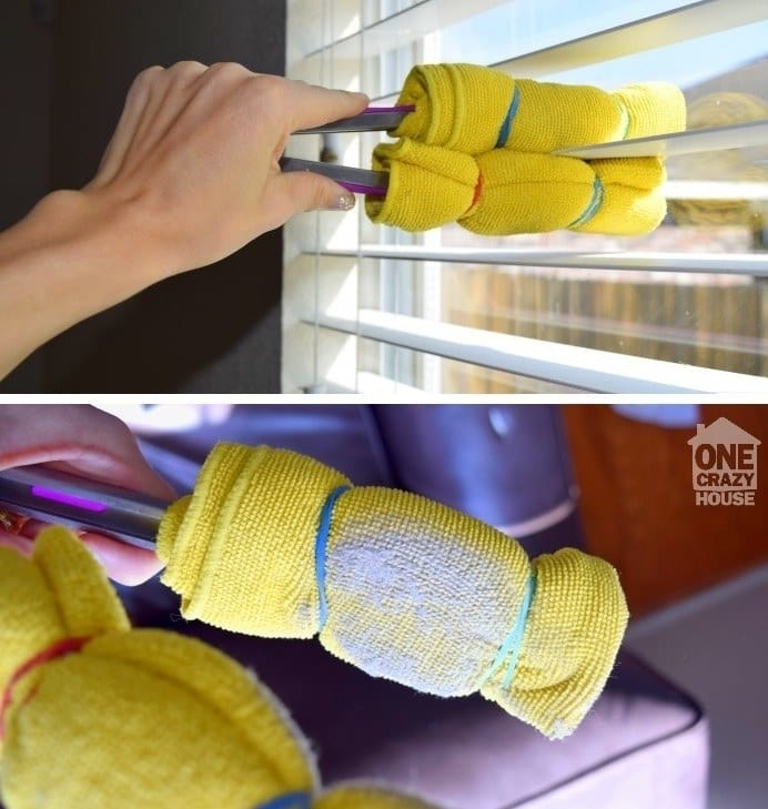 The blogger doing exactly that, using rubber bands to secure the microfiber cloths, which are wrapped around each tong head several times