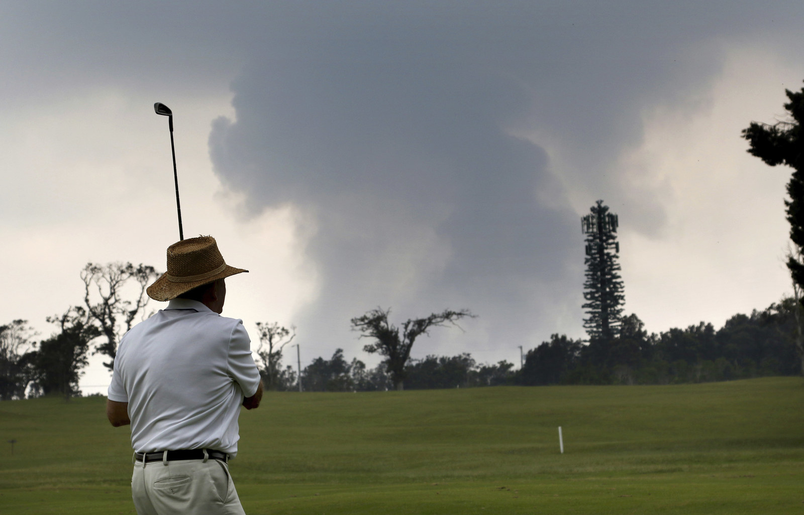 Ken McGilvray, of Keaau, Hawaii, golfs Wednesday.