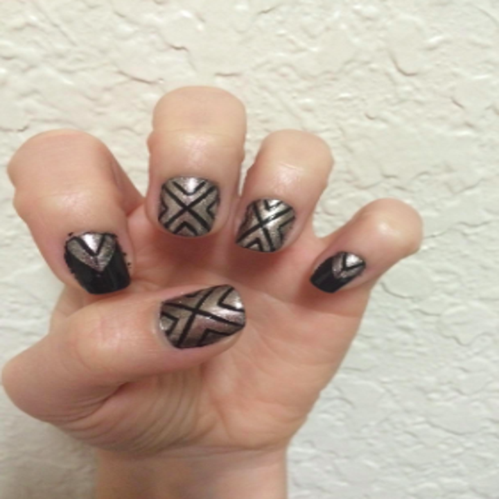 reviewer with shiny well manicured nails