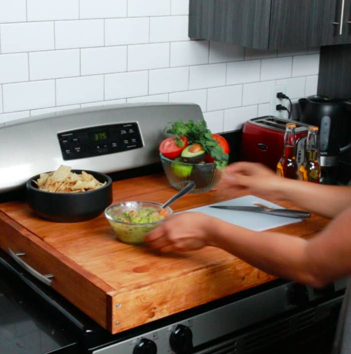 This Stovetop Cover Is Perfect For Kitchens With Limited Counter E