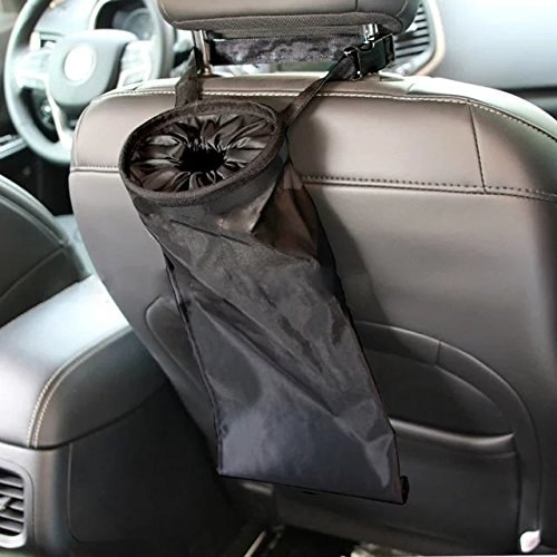 back of a car front passenger seat with a bag-like trash bag attached to it