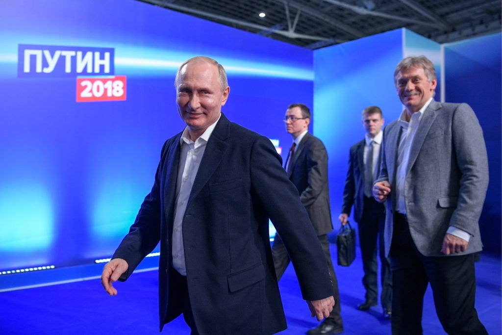 Putin and his spokesman Dmitry Peskov (right).