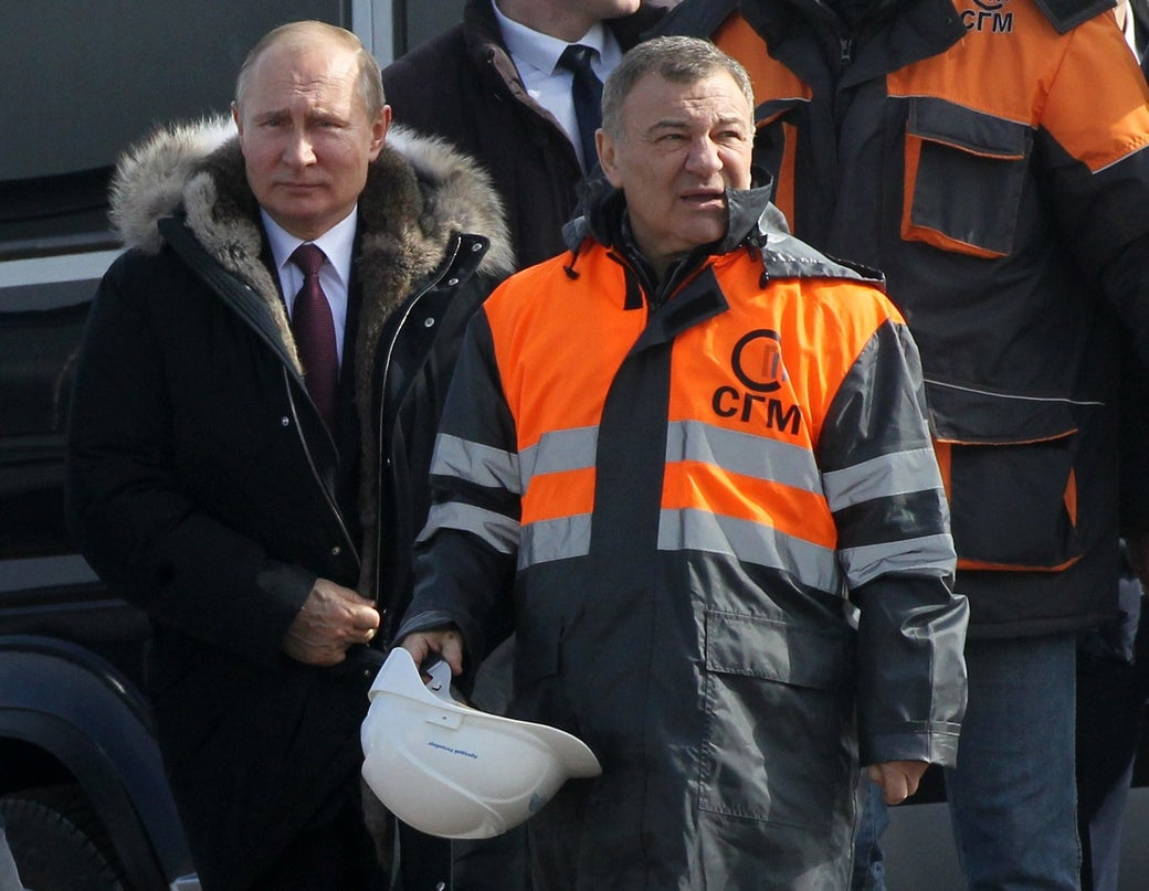 Russian President Vladimir Putin (left) and billionaire Arkady Rotenberg.