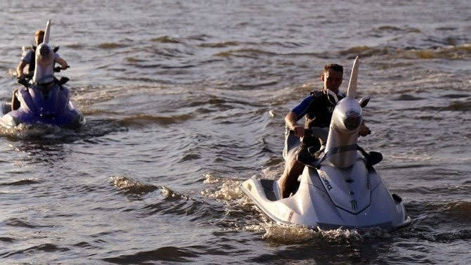 These are just regular jet skis with inflatable unicorn heads on them! Genius.