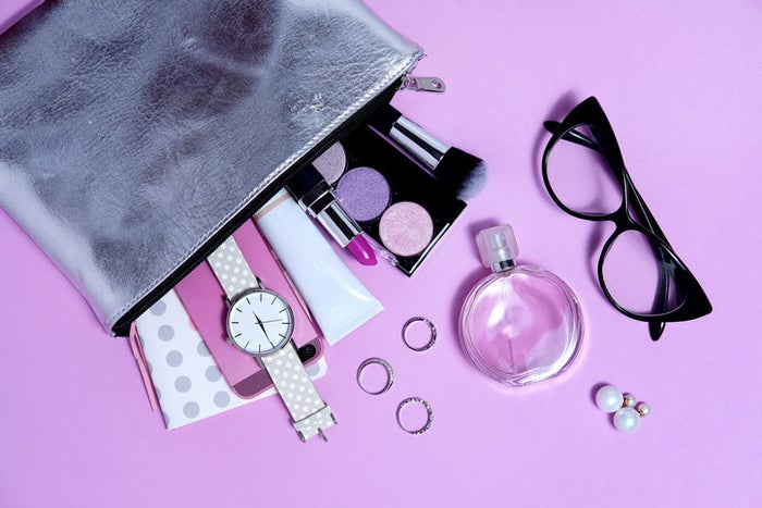You'll want to carry along a few things to make sure you stay flawless the whole night. Here's our checklist to get you started:* Blotting papers to pat your face when you start to get oily.* Your lip gloss or lipstick to do touch-ups before any photo ops.* Bobby pins or hair ties in case that beautiful hairstyle falls down while you're out on the dance floor.* A mini deodorant stick to ensure that you're staying fresh all night long.* A few bandages incase your shoes try to stop you from dancing so hard!* A Tide to Go pen in case any spills occur.* A safety pin (if you're allowed) in case something rips or slips.And lastly, from personal experience, pack a tampon or a pad in there JUST in case. Mother Nature doesn't always play fair. :)