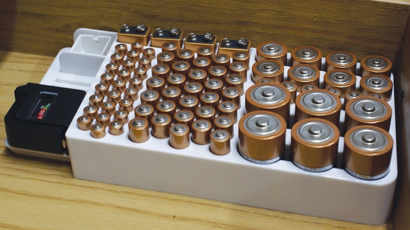 The battery organizer filled with all different sizes of batteries