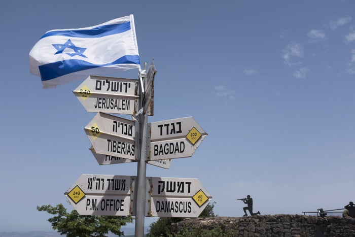 Signs fan out in the Israeli-occupied Golan Heights.