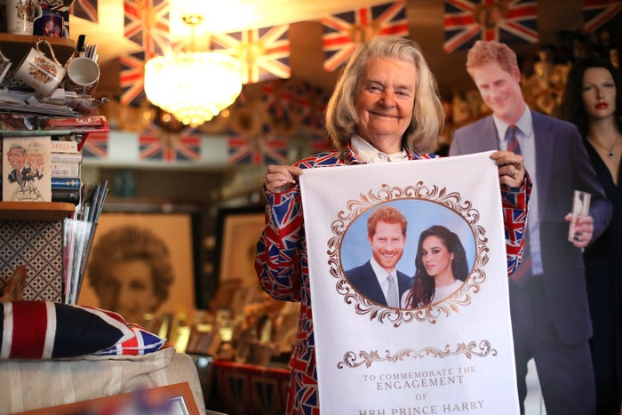 Royal fan Margaret Tyler poses in her north London home, while holding memorabilia celebrating the forthcoming wedding of Prince Harry to Meghan Markle.