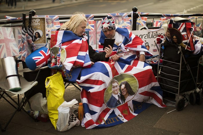Two fans sit outside Windsor Castle ahead of Prince Harry and Meghan Markle's wedding in Windsor, England, on May 16.