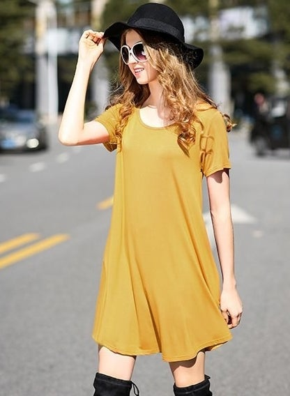 """Promising review: """"I loved this T-shirt dress so much that I ordered three more in different colors! It washes nicely, is extremely comfortable, and is very fairly sized. I'm a women's standard size eight and the medium fit me perfectly with a bit of wiggle room. Amazing deal!!!! Oh, and I'm 5'2"""" and it went just above my knees. Not too long to look granny. I'm still nuts over this dress!"""" —MktgteacherPrice: $5.98+ (available in 25 colors, sizes S–3XL)"""